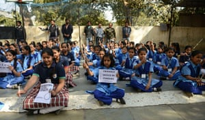 India: Indian schoolchildren hold placards and lighted candles