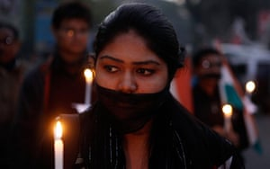 India: An Indian woman participates in a silent procession