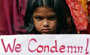 India: Girl holds a placard as she takes part in a protest rally in Hyderabad