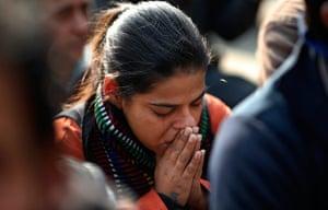 India: A woman cries