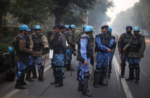 India: Indian anti-riot personnel stand guard