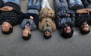 India: Demonstrators lie on a road during a protest in New Delhi