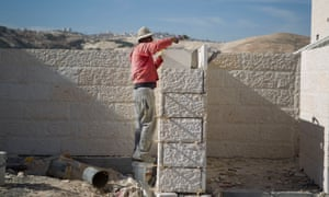 Worker at at a new housing development in the Jewish West Bank settlement of Maaleh Adumim, near Jerusalem, Israel