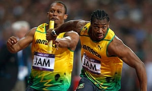 Yohan Blake receives baton from Michael Frater in men's 4x100m relay final at the 2012 Olympic Games