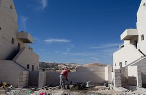 E1 project: A Palestinian man works at a new housing development