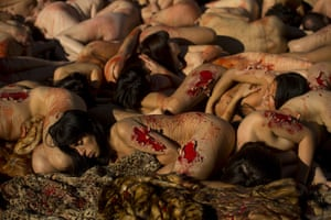 24 hours in pictures: nimaNaturalis protest naked covered with fake blood