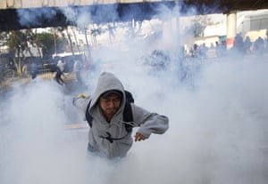 24 hours in pictures: Rioters clash with police  in Mexico
