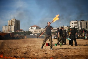 24 hours in pictures: A member of Hamas' national security forces demonstrates his skills