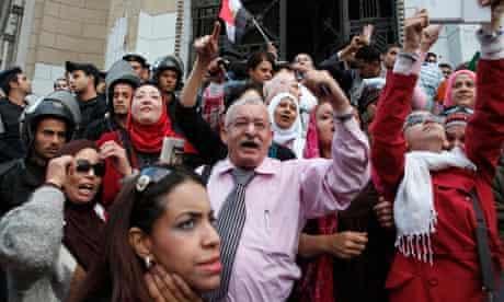 Anti-Morsi protesters chant outside the Supreme Judicial Council building in Cairo, Egypt.