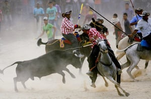 24 hours: A group of riders goad a bull during the Corralejas festivity