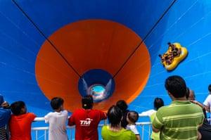 24 hours: A four man raft hurtles down the 46.6 metre Tornado water slide