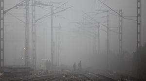 24 hours: People walk across railway tracks in the fog
