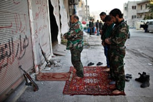 24 hours: Free Syrian army fighters pray at the front line