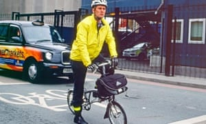 A businessman cycling to work in London
