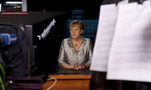 German Chancellor Angela Merkel poses for photographs after the recording of her annual New Year's speech at the Chancellery in Berlin December 30, 2012.