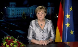 German Chancellor Angela Merkel poses for photographs after the recording of her annual New Year's speech at the Chancellery in Berlin, Germany, on 30 December 2012.