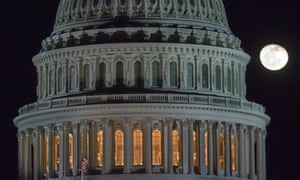 """The moon rises behind the U.S. Capitol Dome in Washington as Congress works into the late evening, Sunday, Dec. 30, 2012 to resolve the stalemate over the pending """"fiscal cliff."""""""