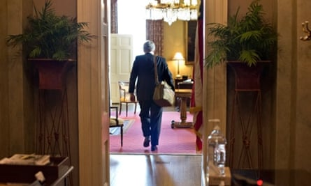 Senate Minority Leader Mitch McConnell of Kentucky, arrives at his office in the Capitol as he and Senate Majority Leader Harry Reid of Neveda try to negotiate a legislative solution to avoid the so-called