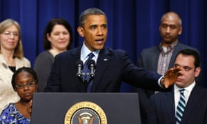 """Barack Obama, surrounded by """"middle class Americans"""" speaks about the fiscal cliff negotiations from the Eisenhower Executive Office Building in Washington."""