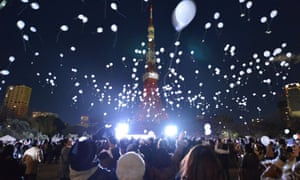 Balloons are released to celebrate the New Year during an annual countdown ceremony in Tokyo