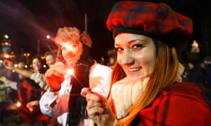 Nadine Rober from Vienna, holds a sparkler during the Hogmanay street party celebrations in Edinburgh