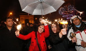 Revellers take part in New Year celebrations near the Arc de Triomphe on the Champs Elysees Avenue