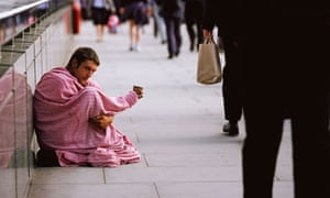 Young man begs in London