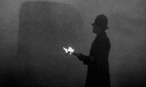 Police using flames at Marble Arch to direct the traffic in London smog 1952