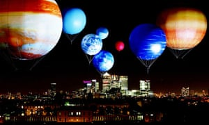 planet balloons float above London