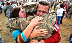 US Army Sergeant Aaron Brewster is welcomed home by his parents during a ceremony in Fort Stewart, Georgia. Around 200 soldiers with the 3rd Infantry Division's 1st Battalion, 64th Armor Regiment, 2nd Armored Brigade Combat Team returned home from their 9-month deployment to Afghanistan.