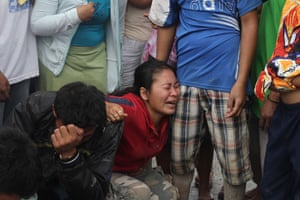 Typhoon Bopha: Relatives mourn as they identify bodies in the in New Bataan