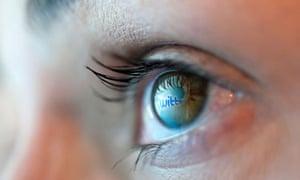 Reflection of Twitter logo in eye
