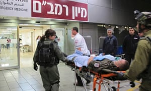 A wounded Austrian peacekeeping soldier  is wheeled into Rambam Hospital in the northern Israeli city of Haifa. Two Austrian peacekeeping soldiers wounded in crossfire in Syria were transferred to Israel for treatment last Friday.