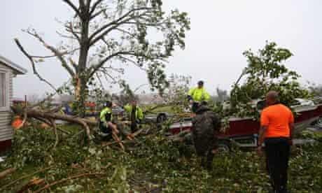 People clear tornado debris in Hobsonville, Auckland, New Zealand