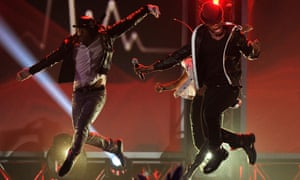 Ne-Yo performs with dancers at The Grammy Nominations Concert Live! at Bridgestone Arena  in Nashville, Tennessee.