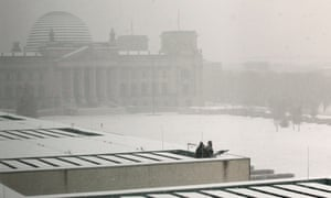 Snipers watch the motorcade of Israeli Prime Minister Benjamin Netanyahu, from the rooftop of the Chancellery during heavy snow in Berlin, Germany. He is arriving for bilateral talks with German Chancellor Angela Merkel.