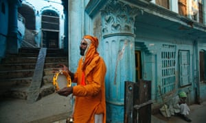 A Hindu holy man plays the tambourine on the 20th anniversary of the Babri mosque demolition in Ayodhya, India. In 1992, tens of thousands of Hindu extremists ripped apart the 16th century mosque  while security forces watched.
