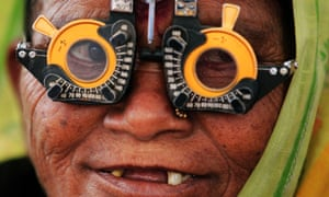 An elderly woman gets a free eye test in Mumbai. f the Indian Constitution, which outlawed discrimination based on caste.