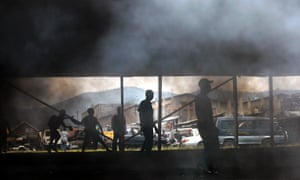 Smoke rises from a burning tyre set alight by in the provincial against what they described as the impotence of the country's armed forces, which allowed a rebel group to overrun the city a little over two weeks ago.