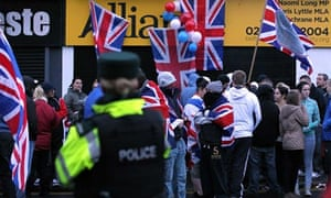Loyalists protest outside an Alliance party office in Belfast