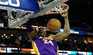Kobe Bryant of the Los Angeles Lakers dunks against the New Orleans Hornets