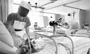 Nurses treating elderly patients