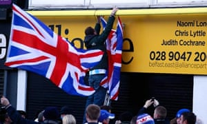 Loyalists hang union flags on Alliance party office, Belfast 4/12/12