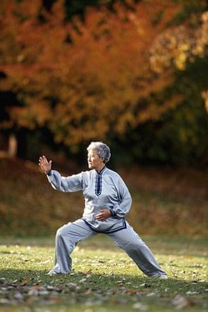 Healthiest cities: Elderly woman tai chi grass