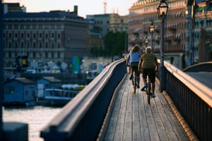 Healthiest cities: Stockholm cyclists crossing bridge