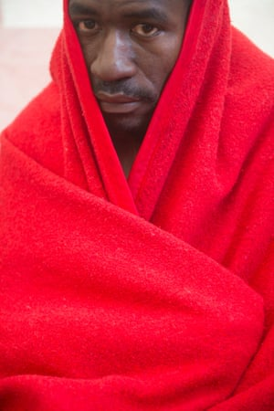 A man wrapped in a blanket after being rescued by Spanish emergency services in the Straits of Gibraltar. Spanish emergency services intercepted four inflatable boats carrying would-be immigrants today.