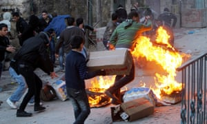 Palestinians protest by burning tyres and throwing stones against Israeli soldiers and security forces in the West Bank city of Hebron.
