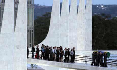 Mourner's follow Oscar Niemeyer's coffin in Brasilia