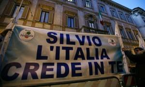 "Supporters of former Italian premier Silvio Berlusconi expose a banner reading ""Silvio Italy trusts you"" in front of Palazzo Grazioli, the residence of Berlusconi, in Rome, Thurdsday, Dec. 6, 2012."