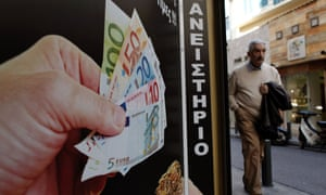 A man in central Athens walks past one of the many pawn shops that have opened in debt-crippled Greece over the past three years.